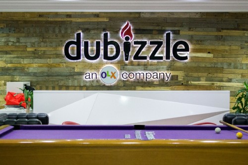 dubizzle company logo and sign. Training article 'dubizzle announces extended maternity and flexible working rights' on Women@Work.