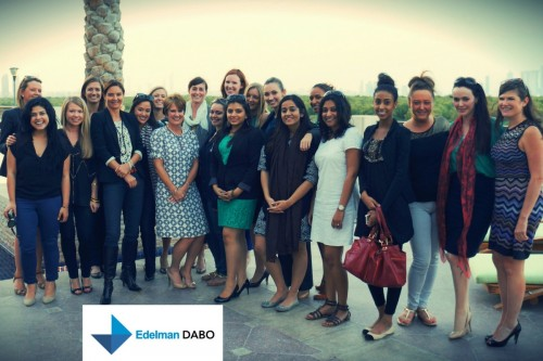 Women from Edelman DABO standing in a line together with company logo. Training article 'Edelman DABO on increasing presence of women in senior levels' on Women@Work.