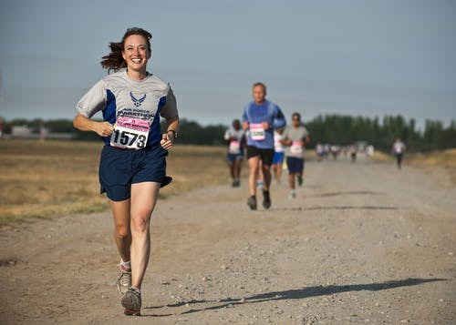 Woman running a race. Training article 'Five skills of an Olympic athlete we can learn from' on Women@Work.